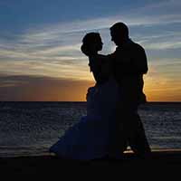 Bride and groom in the sunset.